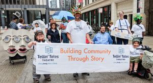 The Tellin' Tales Team shines with pride in the parade